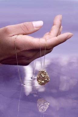 Purple water hand with jewellery, Ocean Republic
