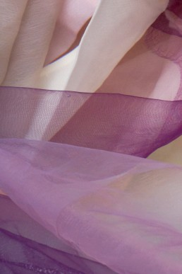Pink purple fabric in water