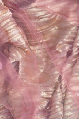 Pink and gold fabric in water